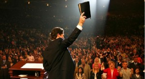 joel-osteen-holding-up-bible